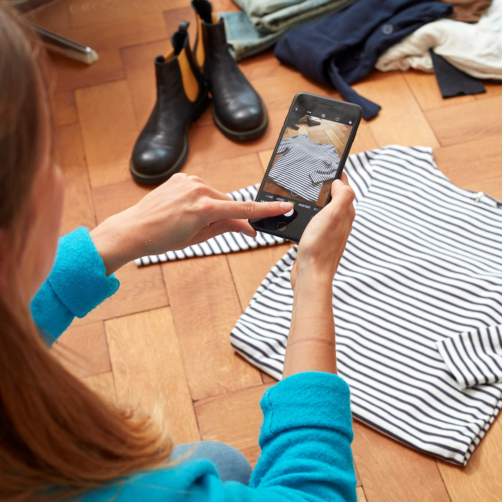 Woman uploading image of shirt onto Zalando Platform